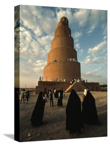 Women Shrouded in Black Approach the Spiral Minaret at Samarra-Lynn Abercrombie-Stretched Canvas Print