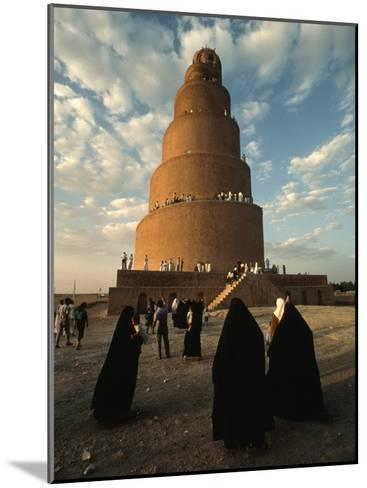 Women Shrouded in Black Approach the Spiral Minaret at Samarra-Lynn Abercrombie-Mounted Photographic Print
