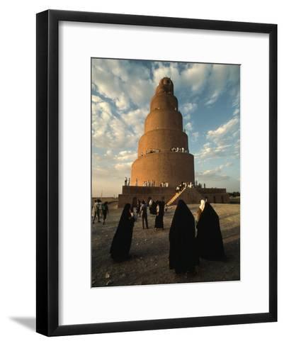 Women Shrouded in Black Approach the Spiral Minaret at Samarra-Lynn Abercrombie-Framed Art Print
