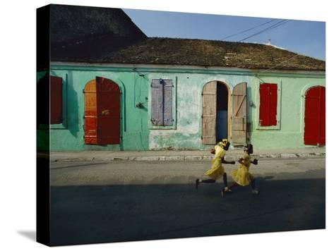 Two Girls Run from the Photographer as He Tries to Take their Picture-James P^ Blair-Stretched Canvas Print