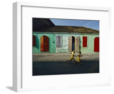 Two Girls Run from the Photographer as He Tries to Take their Picture-James P^ Blair-Framed Art Print