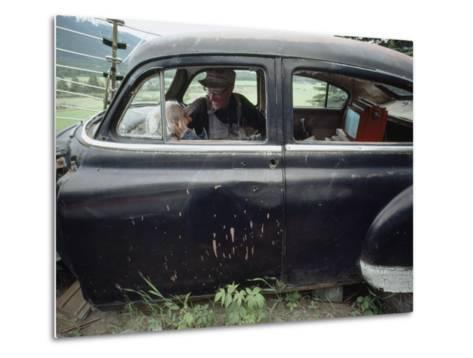A Mother and Son Watch Television in an Old Car-Chris Johns-Metal Print