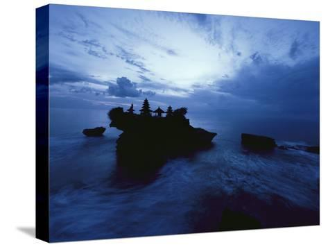 Tanah Lot Temple Stands Perched Atop a Rock in the Indian Ocean-Michael Nichols-Stretched Canvas Print