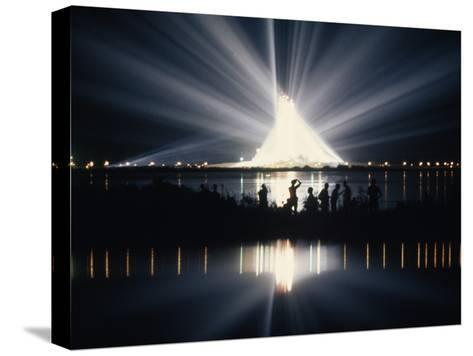 Illuminated by Spotlights, Apollo Ii Gleams and Reflects in a Lagoon-Otis Imboden-Stretched Canvas Print