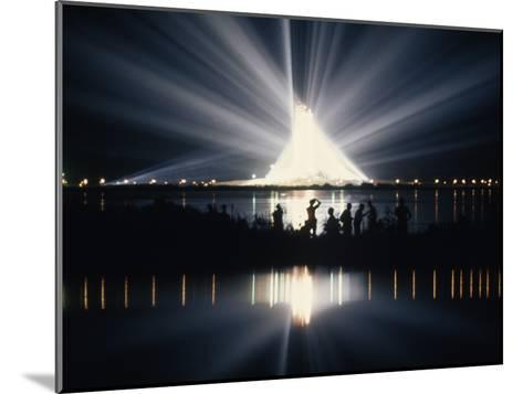 Illuminated by Spotlights, Apollo Ii Gleams and Reflects in a Lagoon-Otis Imboden-Mounted Photographic Print