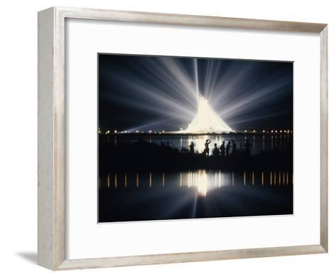 Illuminated by Spotlights, Apollo Ii Gleams and Reflects in a Lagoon-Otis Imboden-Framed Art Print