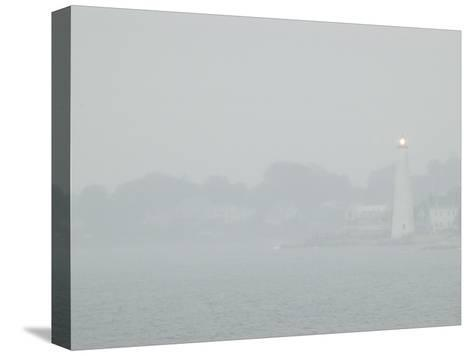 A Lighted Lighthouse Seen Through a Thick Fog on the Thames River-Todd Gipstein-Stretched Canvas Print