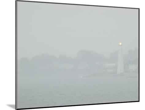 A Lighted Lighthouse Seen Through a Thick Fog on the Thames River-Todd Gipstein-Mounted Photographic Print