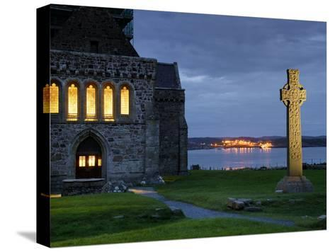 A Celtic Cross Stands Outside the Iona Monastery Church at Dusk-Jim Richardson-Stretched Canvas Print