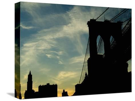 Skyward View of the Brooklyn Bridge Silhouetted Against a Blue Sky-Todd Gipstein-Stretched Canvas Print