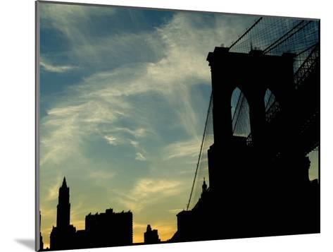 Skyward View of the Brooklyn Bridge Silhouetted Against a Blue Sky-Todd Gipstein-Mounted Photographic Print