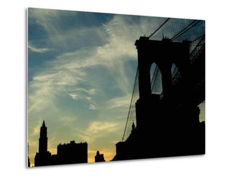 Skyward View of the Brooklyn Bridge Silhouetted Against a Blue Sky-Todd Gipstein-Metal Print