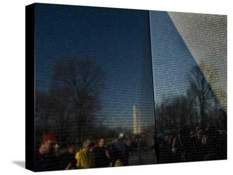 Visitors and Washington Monument Reflected in the Vietnam Memorial-Todd Gipstein-Stretched Canvas Print