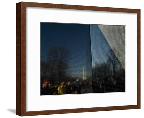 Visitors and Washington Monument Reflected in the Vietnam Memorial-Todd Gipstein-Framed Art Print