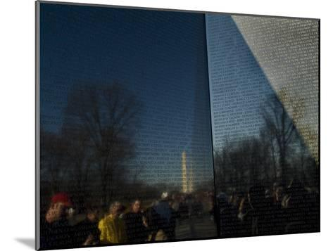Visitors and Washington Monument Reflected in the Vietnam Memorial-Todd Gipstein-Mounted Photographic Print