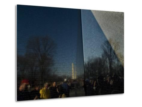 Visitors and Washington Monument Reflected in the Vietnam Memorial-Todd Gipstein-Metal Print
