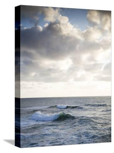 A Lone Wave Breaks as the Clouds Glow at Sunset-Michael Hanson-Stretched Canvas Print
