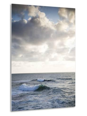 A Lone Wave Breaks as the Clouds Glow at Sunset-Michael Hanson-Metal Print