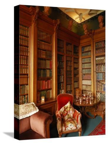 A Red Chair Sits Amid Shelves of Books in Balfour Castle's Library-Jim Richardson-Stretched Canvas Print