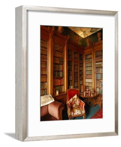 A Red Chair Sits Amid Shelves of Books in Balfour Castle's Library-Jim Richardson-Framed Art Print