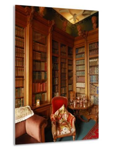 A Red Chair Sits Amid Shelves of Books in Balfour Castle's Library-Jim Richardson-Metal Print