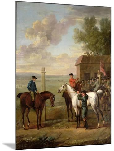 Racehorses with Jockeys Up by the Rubbing Down House on Newmarket Heath-John Wootton-Mounted Giclee Print