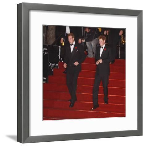 Prince William (left) and his brother Prince Harry arrive for the world premiere of the new James B--Framed Art Print