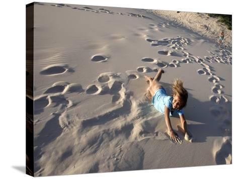 Young Girls Rolling Down Sand Dune-Cathy Finch-Stretched Canvas Print