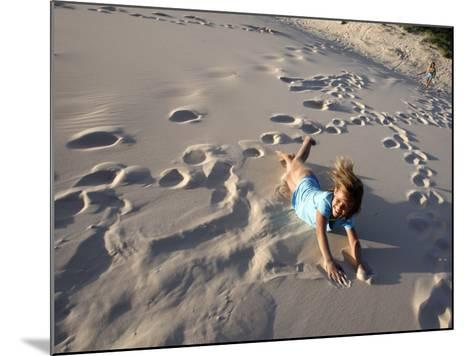 Young Girls Rolling Down Sand Dune-Cathy Finch-Mounted Photographic Print