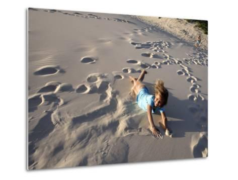 Young Girls Rolling Down Sand Dune-Cathy Finch-Metal Print