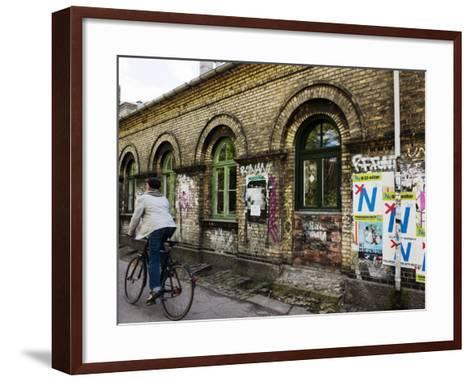 Cyclist in Freetown Christiania, with Anti European Union Posters on Wall-Christian Aslund-Framed Art Print