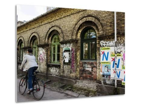 Cyclist in Freetown Christiania, with Anti European Union Posters on Wall-Christian Aslund-Metal Print