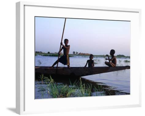 Three Boys Play on a Canoe (Pirogue) on the River in Mopti-Dan Herrick-Framed Art Print