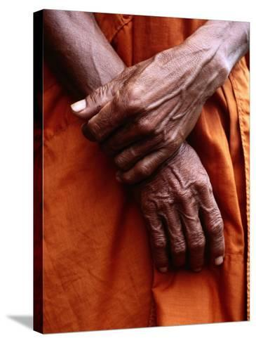 Close Up of Monk's Hands-Daniel Boag-Stretched Canvas Print