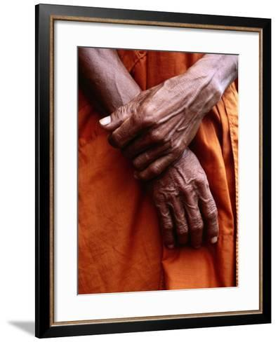 Close Up of Monk's Hands-Daniel Boag-Framed Art Print