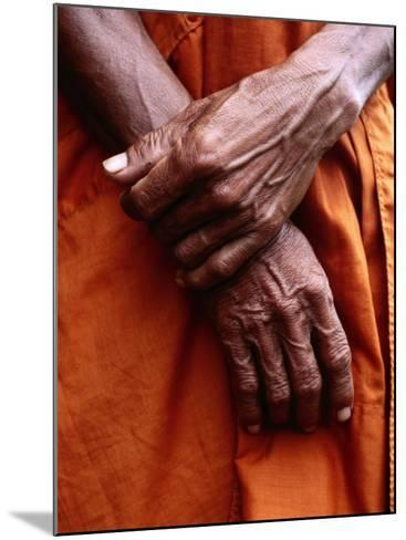 Close Up of Monk's Hands-Daniel Boag-Mounted Photographic Print