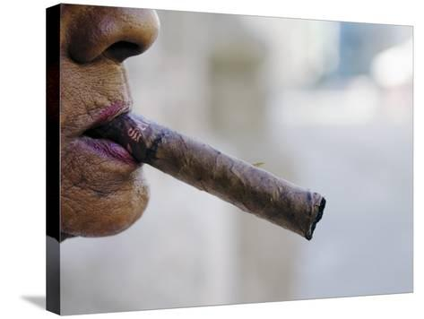 Profile of Cuban Woman Smoking Cigar in Vieja District-Christian Aslund-Stretched Canvas Print