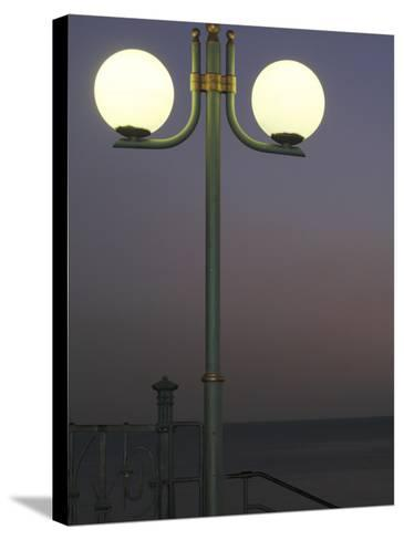 Globe Lamps Overlooking Platja Del Miracle Beach at Dusk-David Borland-Stretched Canvas Print