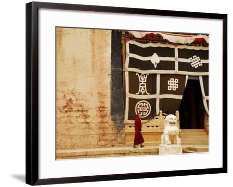 Smiling Monk Walking Towards Entrance to Ganden Sumtseling Gompa (Songzanlin Si) Monastery-Felix Hug-Framed Art Print