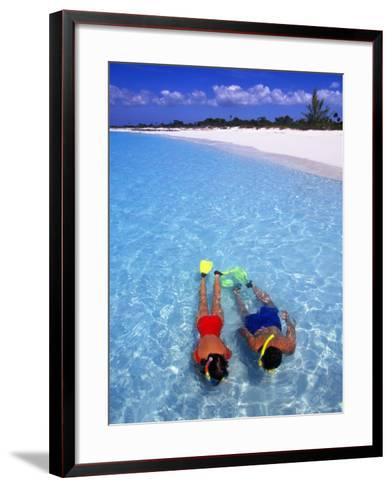 Two People Snorkelling in Blue Water Near Beach-Greg Johnston-Framed Art Print