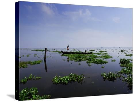Canoe on Kerala's Backwaters-Felix Hug-Stretched Canvas Print