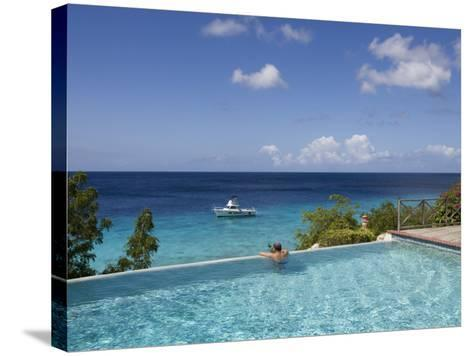 Swimmer in Infinity Pool at Habitat Curacao Dive Resort Near St. Willibrordus-Holger Leue-Stretched Canvas Print