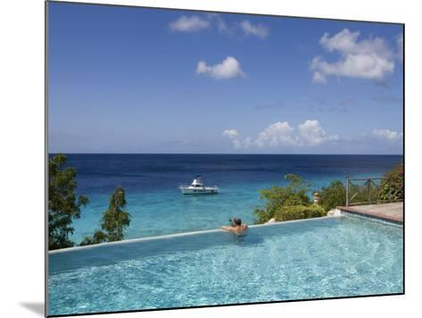 Swimmer in Infinity Pool at Habitat Curacao Dive Resort Near St. Willibrordus-Holger Leue-Mounted Photographic Print