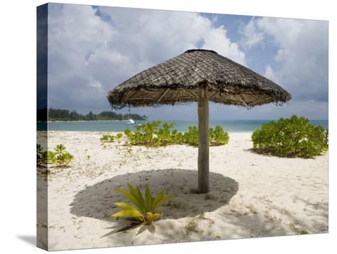 Sun Shade on Beach, Taj Denis Island Resort, Denis Island, Seychelle-Holger Leue-Stretched Canvas Print