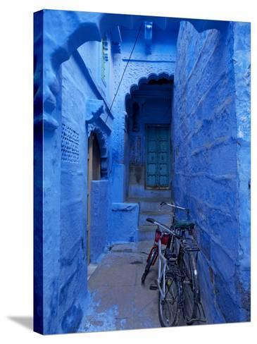 Bicycles Parked in Blue-Painted Laneway-Johnny Haglund-Stretched Canvas Print