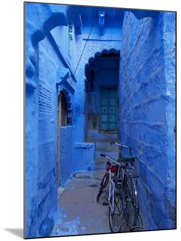 Bicycles Parked in Blue-Painted Laneway-Johnny Haglund-Mounted Photographic Print
