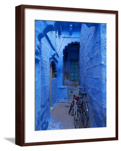 Bicycles Parked in Blue-Painted Laneway-Johnny Haglund-Framed Art Print