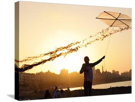 Kite Flyer Along the Corniche-Michael Benanav-Stretched Canvas Print