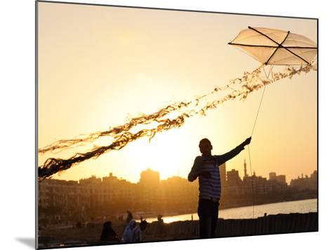 Kite Flyer Along the Corniche-Michael Benanav-Mounted Photographic Print