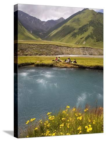 Hiking Group Resting Beside Mineral Spring in Truso Valley-Mark Daffey-Stretched Canvas Print